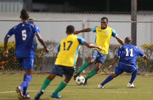Photo: Club Sando Moruga striker Nigel John (second from right) takes on FC Santa Rosa midfielder Durwin Ross during yesterday's CNG National Super League (NSL) Premiership Division action at the Marvin Lee Stadium in Macoya. (Courtesy Nicholas Bhajan/Wired868)