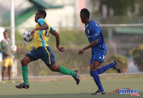 Photo: Club Sando Moruga striker Nigel John (left) sprints away from FC Santa Rosa defender Alfie James during yesterday's CNG National Super League (NSL) Premiership Division action at the Marvin Lee Stadium in Macoya. (Courtesy Nicholas Bhajan/Wired868)