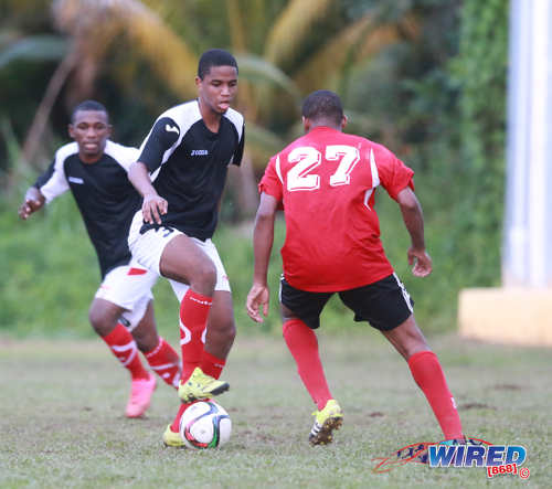 "Photo: Petrotrin Palo Seco forward Tyrell Seales (centre) tries to keep the ball away from Matura ReUnited midfielder Zavion ""Dragon"" Navarro during CNG National Super League Premiership Division action yesterday at the Matura Recreation Ground. (Courtesy Nicholas Bhajan/Wired868)"