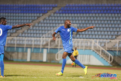 Photo: Police FC sharp shooter Makesi Lewis (right) celebrates after his strike last night against San Juan Jabloteh while teammate and fellow scorer Kareem Freitas looks on. (Courtesy Chevaughn Christopher/Wired868)