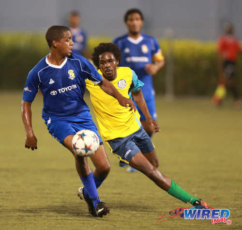 Photo: FC Santa Rosa midfielder Jesse Reyes (left) tries to keep the ball away from Club Sando Moruga midfielder Kyle Morgan during 2015/16 CNG National Super League (NSL) Premiership Division action at the Marvin Lee Stadium in Macoya. (Courtesy Nicholas Bhajan/Wired868)