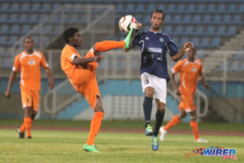Photo: Club Sando midfielder Akeem Humphrey (centre) flicks the ball over Morvant Caledonia United midfielder Kyle Bartholomew during 2015/16 Pro League action last night at the Ato Boldon Stadium, Couva. (Courtesy Chevaughn Christopher/Wired868)
