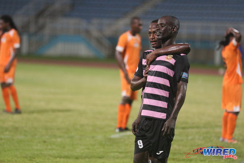 "Photo: North East Stars striker Gorean ""Ratty"" Highley is congratulated by a teammate after his decisive goal yesterday against Club Sando in Couva. (Courtesy Chevaughn Christopher/Wired868)"