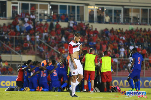 Photo: Trinidad and Tobago defender Radanfah Abu Bakr (centre) walks away while Haiti players celebrate their 1-0 win in the 2016 Copa America play off contest at the Rommel Fernandez Stadium, Panama City on 8 January 2016.  (Courtesy Allan V Crane/CA-images/Wired868)