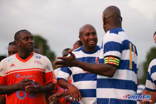 Photo: Wired868 director Lasana Liburd (centre) and captain Leonson Lewis (right) conduct a post-mortem while Darin Lewis spies on the opposition during the 2016 Wired868 Football Festival. (Courtesy Allan V Crane/Wired868)
