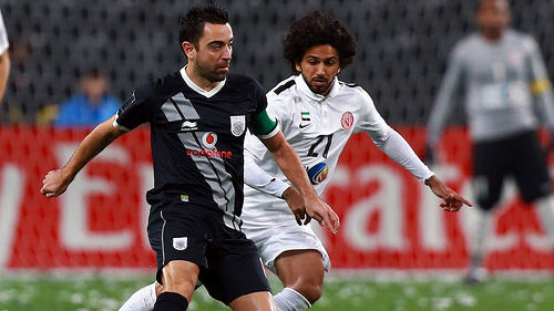 Photo: Al Saad midfielder and ex-Spain and Barcelona legend Xavi (left) in action against Al Jazira in an AFC Champions League play off contest yesterday on 9 February 2016. (Copyright Dream Team FC)