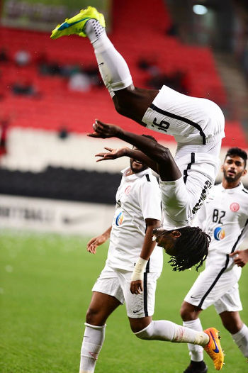 Photo: Trinidad and Tobago forward Kenwyne Jones celebrates a goal for UAE club, Al Jazira, against Al Saad with a trademark somersault during AFC Champions League play off action on 9 February 2016. (Courtesy KJ Media)