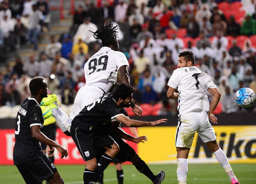 Photo: Al Jazira and Trinidad and Tobago forward Kenwyne Jones (centre) heads home during an AFC Champions League play off contest against Al Saad on 9 February 2016. (Courtesy KJ Media)