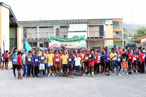 Photo: Students, teachers, parents and well-wishers prepare to face the starting gun for Arima North Secondary's 5K against school violence and bullying. (Courtesy Arima North Secondary)