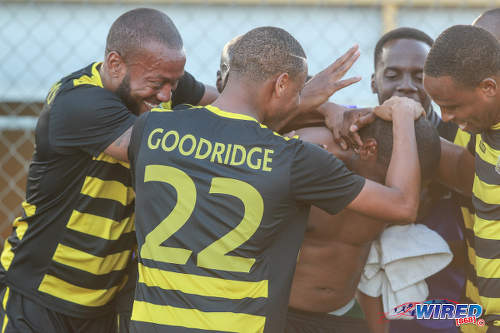 Photo: Defence Force players surround Christon Baptiste (centre) after his stunning strike against Stokely Vale  during NSL Premiership Division action yesterday in Macoya. (Courtesy Nicholas Bhajan/Wired868)