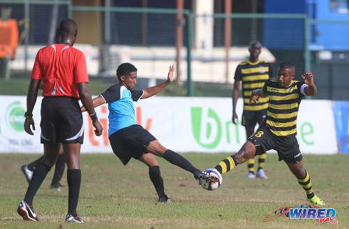 Photo: WASA FC attacker Shane Calderon (left) and Defence Force skipper Christopher Durity contest the ball during CNG National Super League Premiership Division action in St Joseph. (Courtesy Nicholas Bhajan/Wired868)