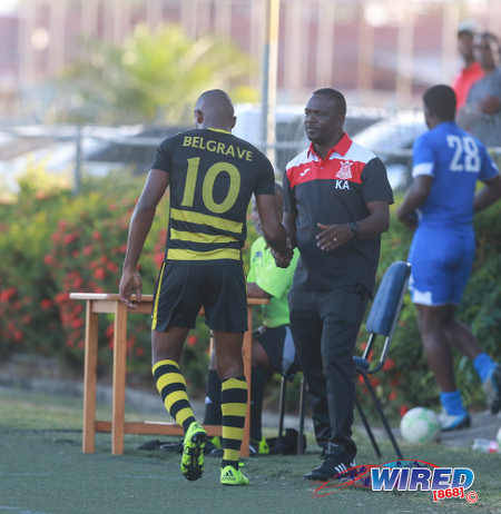 Photo: Defence Force coach Kelshall Alexander (right) offers a hand to star attacker Josimar Belgrave  during NSL Premiership Division action yesterday in Macoya. (Courtesy Nicholas Bhajan/Wired868)