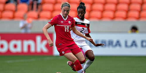 Photo: Trinidad ad Tobago left back Janelle Cunningham (right) tries to stay close to Canada attacker Janine Beckle during CONCACAF action. (Courtesy MexSport/CONCACAF)