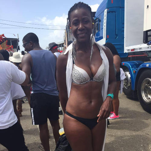 Photo: Former People's Partnership Senator Christlyn Moore enjoying her 2016 Carnival. Or, as Raymond Tim Kee would put it, auditioning for a role in a domestic abuse case. (Courtesy Facebook)