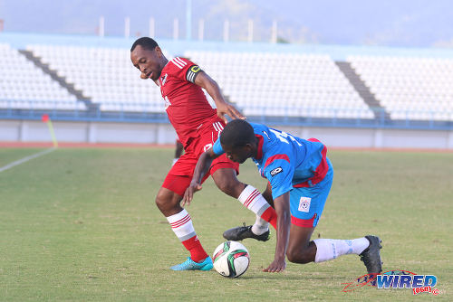 Photo: Central FC captain Leston Paul (left) holds off St Ann's Rangers defender Sedale McLean during TT Pro League action on 20 February 2016. (Courtesy Chevaughn Christopher/Wired868)