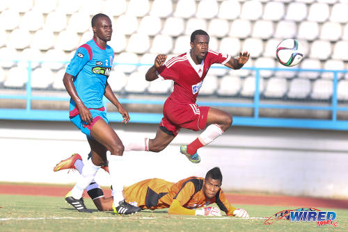 Photo: Central FC attacker Marcus Joseph (centre) scores the game winner on 20 February 2016 while St Ann's Rangers defender Shakiyl Phillip (left) and goalkeeper Christopher Biggette watch on. (Courtesy Chevaughn Christopher/Wired868)