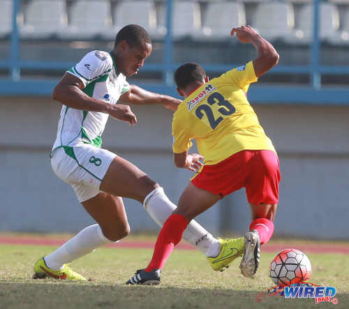 Photo: North East Stars winger Brendon Figuera (right) tries to get away from W Connection midfielder Briel Thomas during 2015/16 Pro League action yesterday at the Larry Gomes Stadium. (Courtesy Nicholas Bhajan/Wired868)