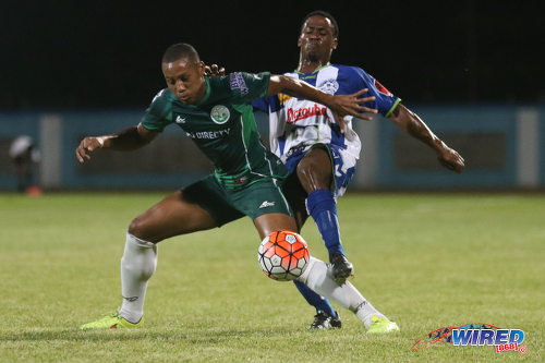 Photo: W Connection midfielder Briel Thomas (left) holds off Club Sportif Moulien midfielder Willis Francillonne during 2016 Caribbean Club Championship action in Couva on 26 February 2016. (Courtesy Chevaughn Christopher/Wired868)