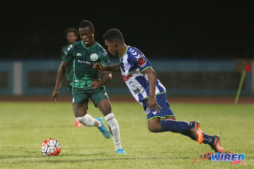 Photo: W Connection attacker Jabari Mitchell (left) in action against Club Sportif Moulien during 2016 Caribbean Club Championship action in Couva on 26 February 2016. (Courtesy Chevaughn Christopher/Wired868)