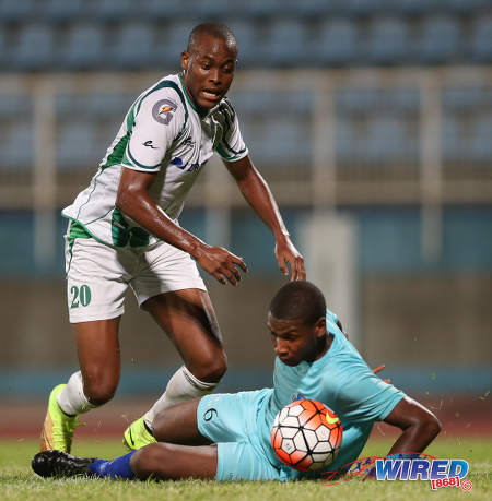 Photo: W Connection forward Jamal Charles (left) takes on an Atlantico FC defender during 2016 Caribbean Club Championship action last night in Couva. (Courtesy Allan V Crane/CA-images/Wired868)