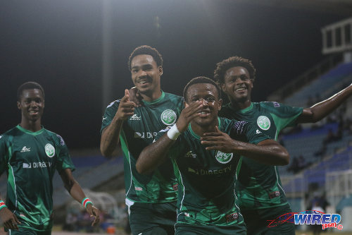 Photo: W Connection players (from right) Triston Hodge, Jomal Williams, Alvin Jones and Dimitrie Apai celebrate during 2016 Caribbean Club Championship action against Club Sportif Moulien in Couva on 26 February 2016. (Courtesy Chevaughn Christopher/Wired868)