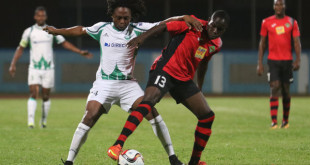 Photo: Battle of the maestros. San Juan Jabloteh midfielder Fabian Reid (right) tries to hold off W Connection playmaker Andre Toussaint during 2015/16 Pro League action tonight at the Ato Boldon Stadium. (Courtesy Chevaughn Christopher/Wired868)