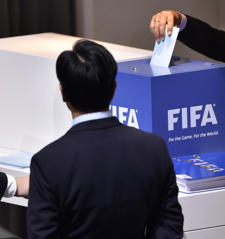 Photo: A FIFA delegate prepares to cast his ballot in the 2016 FIFA presidential election today in Zurich. (Copyright AFP 2016/Fabrice Coffrini)
