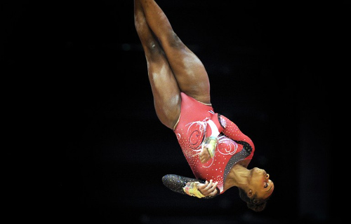 Photo: Thema Williams of Trinidad and Tobago competes on the uneven bars during the 2015 World Gymnastics Championship in Glasgow, Scotland, on 23 October 2015. (Copyright AFP 2016/Andy Buchanan)
