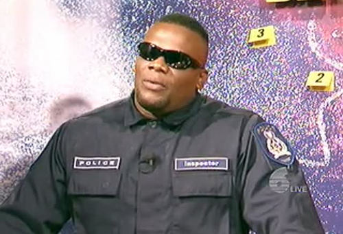 Photo: Dontcha wish your crime show host was bad like me... Dontcha! (Courtesy TV6)