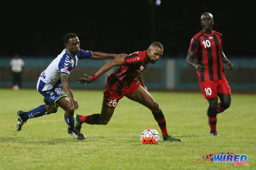 Photo: Inter Moengo Tapoe attacker Stefano Rijssel (centre) turns on a Club Sportif defender during 2016 Caribbean Club Championship action last night in Couva. (Courtesy Chevaughn Christopher/Wired868
