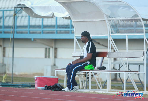 Photo: La Horquetta SA manager Errol Jointe cuts a lonely figure on the bench, as he tries to help his hometown team avoid relegation. (Courtesy Nicholas Bhajan/Wired868)