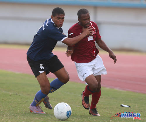 Photo: Bethel United right back Daniel Craig (left) tries to hold off La Horquetta SA midfielder Kern Roberts during 2015/16 CNG NSL Premiership Division action. (Courtesy Nicholas Bhajan/Wired868)