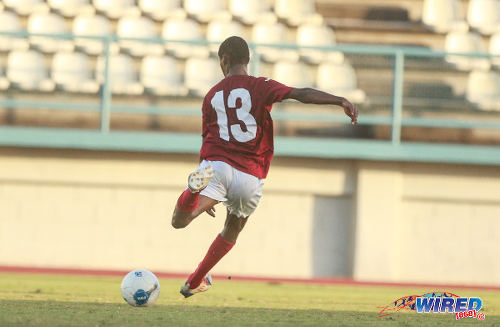 Photo: La Horquetta SA midfielder Taje Commissiong prepares to drive him his wonder goal from distance against Bethel United in CNG NSL Premiership Division action. (Courtesy Nicholas Bhajan/Wired868)