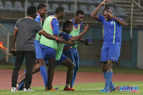 Photo: Police FC captain Todd Ryan (far right) is congratulated his bench after his strike against Club Sando in 2015/16 Pro League action. (Courtesy Chevaughn Christopher/Wired868)