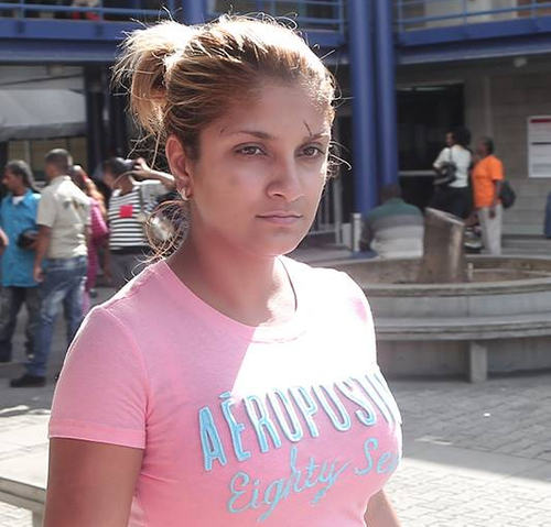 Photo: Rachael Suhkdeo has pressed charges against her husband, Sheron Suhkdeo, for domestic violence. (Courtesy Trinidad Guardian)