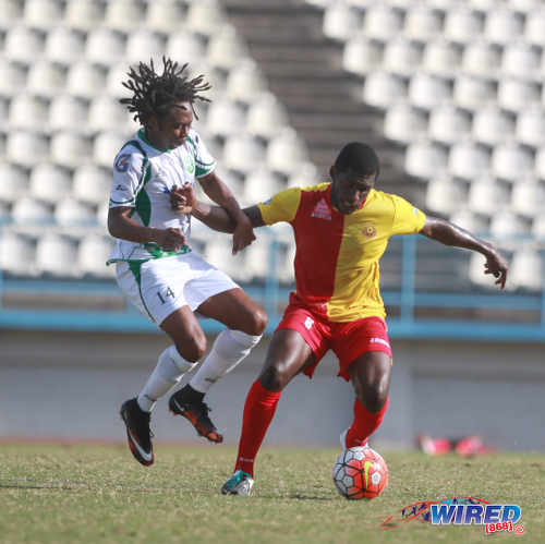 Photo: North East Stars midfielder Neveal Hackshaw (right) holds off W Connection playmaker Andre Toussaint during 2015/16 Pro League action yesterday at the Larry Gomes Stadium in Malabar. (Courtesy Nicholas Bhajan/Wired868)