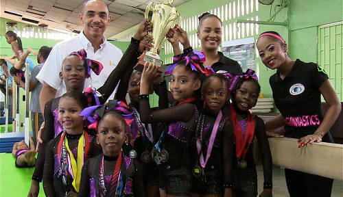 Photo: TTGF second vice-president Ricardo Lue Shue (back left) poses with young gymnasts in Trinidad and Tobago. (Copyright TT Sportslink)