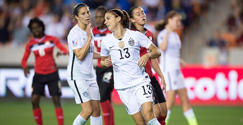 Photo: United States striker Alex Morgan (centre) scored a hattrick against Trinidad and Tobago in the semifinals of the CONCACAF 2016 Olympic qualifying series. (Courtesy MexSport/CONCACAF)