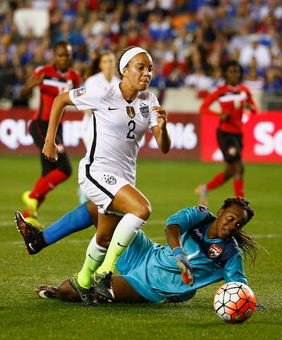 Photo: United States attacker Mallory Pugh (left) tries to take the ball around Trinidad and Tobago goalkeeper Kimika Forbes during the semifinals of the CONCACAF 2016 Olympic qualifying series. (Copyright AFP 2016/Scott Halleran)