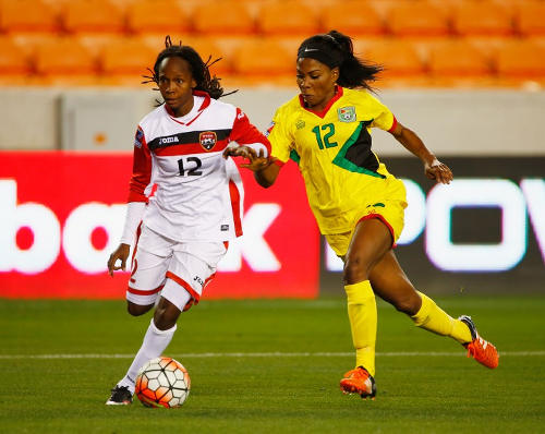 Photo: Trinidad and Tobago attacker Ahkeela Mollon (left) bursts past Guyana mdifielder Otesha Charles during CONCACAF 2016 Olympic qualifying action last night in Houston. (Copyright AFP 2016/Scott Halleran)