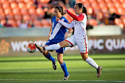 Photo: Trinidad and Tobago defender Arin King (right) nicks the ball away from Guatemala attacker Diana Barrera during 2016 Olympic qualifying action on Thursday. (Courtesy CONCACAF)