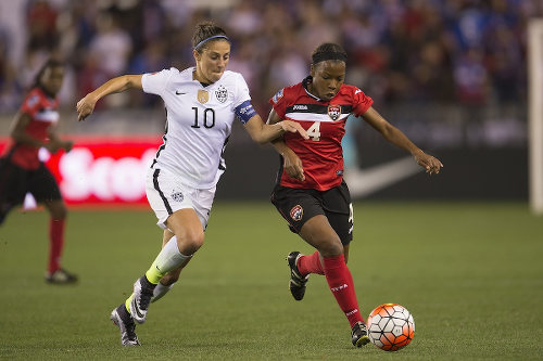 Photo: Trinidad and Tobago defender Danielle Blair (right) tries to stay close to United States captain and FIFA World Player of the Year, Carli Lloyd, Photo: Trinidad and Tobago defender Karyn Forbes (left) tries to stop United States captain and FIFA World Player of the Year, Carli Lloyd, during the semifinals of the CONCACAF 2016 Olympic qualifying series. (Courtesy Osvaldo Aguilar/MexSport/CONCACAF)