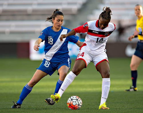 Photo: Trinidad and Tobago defender Karyn Forbes (right) keeps the ball away from Guatemala attacker Diana Barrera during last Thursday's 2016 Olympic qualifying action. (Courtesy CONCACAF)