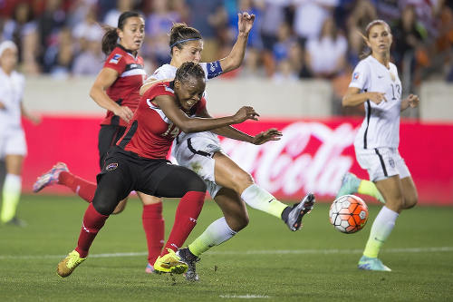 Photo: Trinidad and Tobago defender Karyn Forbes (left) tries to stop United States captain and FIFA World Player of the Year, Carli Lloyd, during the semifinals of the CONCACAF 2016 Olympic qualifying series. (Courtesy CONCACAF)