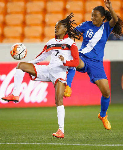 Photo: Trinidad and Tobago attacker Kayla Taylor (left) tries to hold off Guatemala defender Kellin Mayen during 2016 Olympic qualifying action on Thursday. (Courtesy CONCACAF)