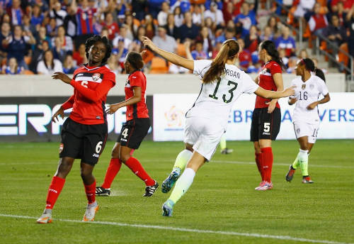 Photo: United States striker Alex Morgan (centre) wheels away to celebrate another goal while Trinidad and Tobago player Khadidra Debesette (left) looks on during the semifinals of the CONCACAF 2016 Olympic qualifying series. (Copyright AFP 2016/Scott Halleran)