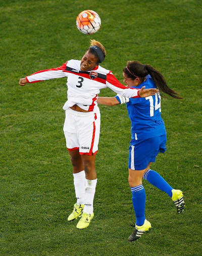 Photo: Trinidad and Tobago striker Mariah Shade (left) wins a header against Guatemala defender Coralia Monterroso during CONCACAF 2016 Olympic qualifying action. (Courtesy MexSport/CONCACAF)