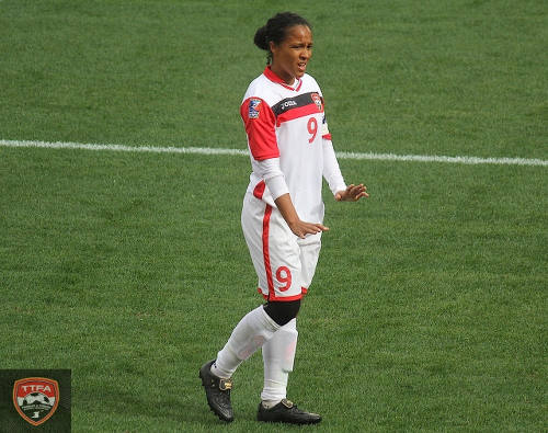 Photo: Trinidad and Tobago captain Maylee Attin-Johnson gestures to her teammates during their 2016 Olympic qualifier against Canada on February 14. (Courtesy TTFA Media)