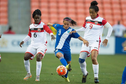 Photo: Trinidad and Tobago players Khadidra Debesette (left) and Maylee Attin-Johnson (right) try to close down Guatemala midfielder Marilyn Rivera during 2016 Olympic qualifying action last Thursday. (Courtesy CONCACAF)