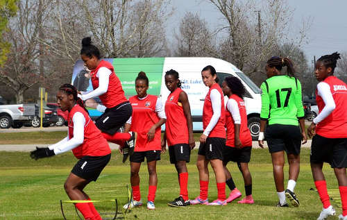 "Photo: Trinidad and Tobago captain Maylee Attin-Johnson (second from left) and the ""Women Soca Warriors"" get ready for 2016 Olympic qualifying action in Houston. (Courtesy TTFA Media)"